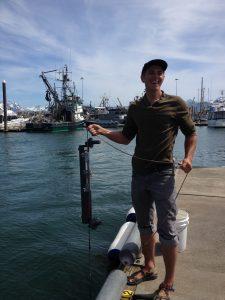 Jim Schloemer from KBRR holds sampling apparatus in the Homer harbor.